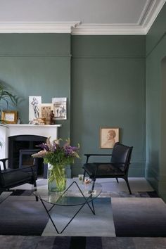 Farrow & Ball Smoke Green painted walls in a living room with European sophisticated style. #farrowandball #smokegreen #paintcolors #deepgreen #moodygreen #greenpaint