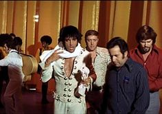 Elvis after his Las Vegas concert in august 12 1970 with Joe Esposito beside him.