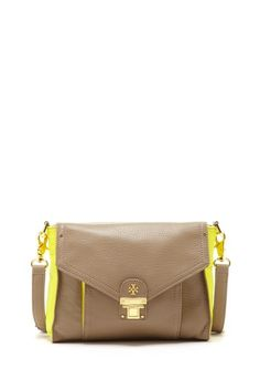 """Tory Burch - Rachel Crossbody Clutch $225.00  About This Item  - Detachable shoulder strap  - Zip top closure  - Tory Burch signature emblem detail  - Exterior features slip back pocket and front flap pocket with push-lock closure  - Interior features zip wall pocket and 2 media pockets  - Fully lined  - Approx. 6.5"""" H x 9"""" W x 3"""" D  - Approx. 22"""" strap drop  - Imported"""