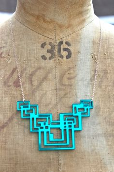 Tron Laser-Cut Large Geometric Necklace, Teal Mirrored Acrylic Perspex. $34.00, via Etsy.