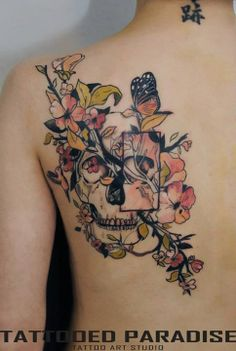 Skull and flowers tattoo @kels9210 I'm also contemplating something like this for my quarter sleeve..