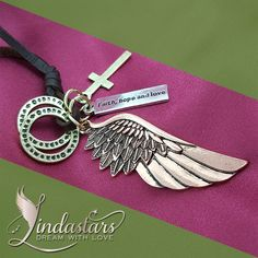 """Let your love catch a glimpse of true deeper self with this highly symbolic Angel of Deliverance #Necklace. Made from leather, accompanied by two eternity circles, holy cross, a angel wing and a meaning quote of """"Faith, Hope and Love"""" which will inbound you to establish an eternal connection with the angels in heaven. She will always bless you with her grace and makes you feel more complete…"""