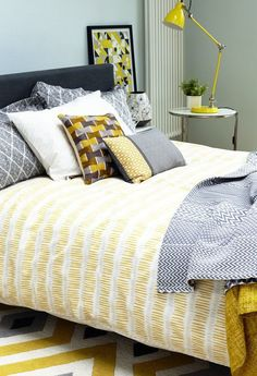 Create a vibrant and modern bedroom with bold blocks, zigzags and stripes in mustard, charcoal and chartreuse. Make your bed the focal point of the room with striking graphic printed bedlinen.   - housebeautiful.co.uk