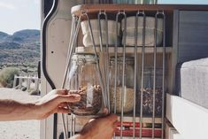 Van Life Storage and Organization Ideas Great organization hack to keep things in place in a DIY campervan conversion! There is a lot of good advice and ideas in this article for organizing your kitchen bathroom and tiny living area. A must read for someo Astuces Camping-car, Kombi Home, Van Living, Living Area, Camper Van Conversion Diy, Van Conversion Kitchen, Diy Van Camper, Camper Van Kitchen, Van Conversion Interior