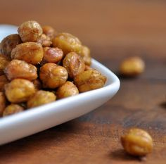 coat chickpeas with olive oil, salt, cayenne pepper, paprika and cumin, roast on a baking sheet for ~45 min at 375. spicy roasted chick peas!!