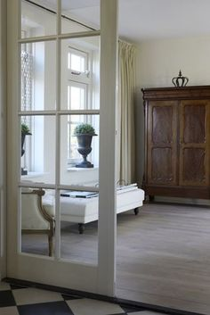 Haus Design - love the light wood, the checkered marble floor and the interior french doors. and the urn. My Living Room, Home And Living, Living Spaces, French Door Windows, Windows And Doors, French Doors, French Armoire, Interior Decorating, Interior Design