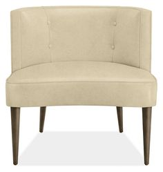 The curved, button-tufted back of this small-scale accent chair offers surprising comfort. Chloe's personality shines through in the details: precise welting, tapered legs and a subtle inward contour on the front of the seat.