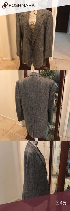 Classic tweed sports jacket by Paco Rabanne Classic Paco Rabanne sports jacket in black and white tweed, one breast pocket plus two flap pockets, back vent. Gently worn, excellent condition. Paco Rabanne Jackets & Coats