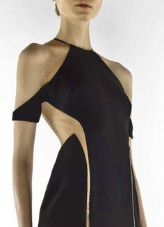 Dion Lee. I wish the image quality was a wee bit better. I like this dress design; the placement of the cut out panels and the almost negative space of the mesh making the design a whole is quite interesting and form flattering.