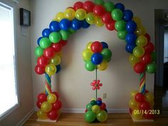 Balloon arch and a topiary column