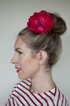 Hair Romance red flower topknot--she has the perfect nose!!!