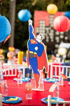 Superman guest table from a Calling All Superheroes Birthday Party on Kara's Party Ideas | KarasPartyIdeas.com (26)