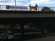 Reward Dalai Lama banner over highway in Melbourne