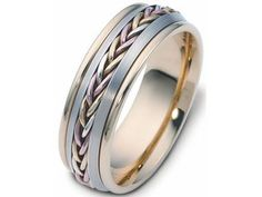 Men's 18kt three tone woven Dora wedding ring    Style number: A11735  The men's wedding ring pictured is made in a combination of 18kt yellow, white and rose gold. The band pictured is made in polished yellow ribbed edges. The center of the band features matte satin finished white gold with a woven section through the center. The weave is made in white, yellow and rose gold. The ring pictured measures 7mm wide.    This wedding ring is part of the Dora brand of wedding rings. The Dora code…
