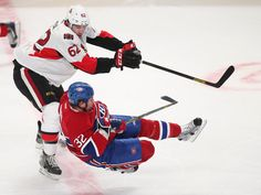 Montreal Canadiens' Travis Moen (R) is upended by Ottawa Senators' Eric Gryba during the first period of their NHL hockey action in Montreal, March 13, 2013. REUTERS/Christinne Muschi