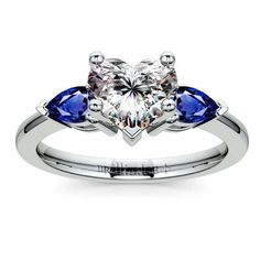Beautiful blue hues bring glamorous diamond sparkle to its most beautiful yet... Pop the question with the Pear Sapphire Gemstone Ring in Platinum, featuring a gorgeous Heart-cut diamond center stone!  http://www.brilliance.com/engagement-rings/pear-sapphire-gemstone-ring-platinum
