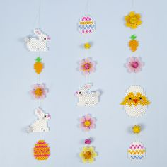 Make this lovely Easter garland from four Nabbi fuse bead figures; an Easter chick, an Easter bunny, Easter eggs and flowers. All the figures are made from a mix of Nabbi fuse beads in glitter, mother-of-pearl and standard colours. Pearler Bead Patterns, Pearler Beads, Fuse Beads, Bead Crafts, Diy And Crafts, Crafts For Kids, Easter Festival, Pearl Beads Pattern, Easter Garland