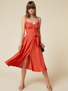 Pretty damn pretty. This is a button front, calf length dress with a sweetheart neckline and detached belt.