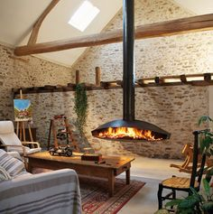 Fireplace ties a room together like no other piece of interior can. It starts luring book shelves, wine bottles and class in general. With a fireplace, your room is warm both literally and metaphorically. Focus Fireplaces, Barn Conversion Interiors, Hanging Fireplace, Suspended Fireplace, Floating Fireplace, Fireplace Design, Custom Fireplace, Modern Fireplaces, Faux Fireplace