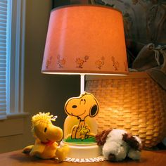 For Sale – Snoopy & Woodstock Nursery Lamp – Kindle a love of Snoopy for your new baby with a Peanuts nursery lamp. The vintage 1982 Snoopy and Woodstock lamp is in full-working order, comes with the original shade and is available in our shop at CollectPeanuts.com. Snoopy Nursery, Woodstock Snoopy, Boy Room, Kids Room, Snoopy Toys, Nightlights, Peanuts Snoopy, Baby Boy Nurseries, Room Themes