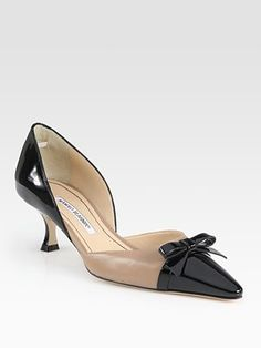 How classy and cute are these? Beige-Black Patent Leather Point Toe d'Orsay Pumps by Manolo Blahnik