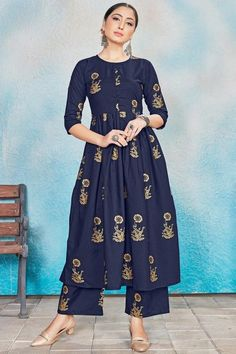 Cast a spell with this navy blue rayon trouser suit which features beautiful print work. This round neck and 3/4th sleeve suit adorned with foil print work. Accompanied by a matching rayon straight pants in navy blue color with navy blue chiffon dupatta . Straight pants has foil print work. #trousersuit #salwarkameez #malaysia #Indianwear #Indiandresses #andaazfashion Blue Trousers, Trouser Suits, Pantalon Cigarette, Navy Blue Color, Jacket Style, Indian Dresses, Indian Wear, Different Styles, Marie