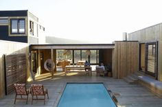 This modern surfer& home uses tons of wood and other casual materials to make for a cool, beach house tour.