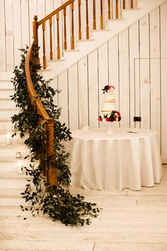 Photo: A Nomadic Love I Flowers: Moss Floral Design I Venue: The White Sparrow Staircase greenery