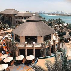 The beautiful thatched roofs of the Sofitel Hotel & Resort, Palm Jumeirah, Dubai. Round House Plans, Sofitel Hotel, Palm Jumeirah, Luxury Pools, Thatched Roof, Pool Bar, Concrete Jungle, Hotels And Resorts, Gazebo