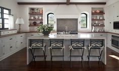 Seating- wooden bar stools contrasting the kitchen cabinetry and counter tops.