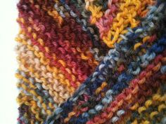 Detail of neck on diagonally knitted cowl