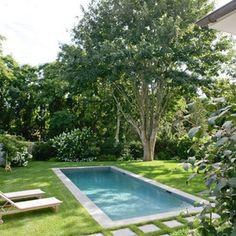 love the grass around the rectangular pool