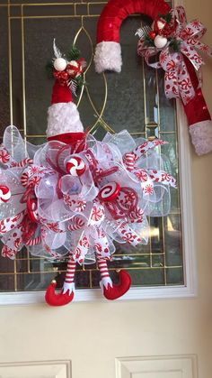 The cutest elf hat and candycane wreaths. The elf hat has a multuspeed battery operated lights and the cane cane lights up with a steadybattery light pack Gingerbread Christmas Decor, Grinch Christmas Decorations, Christmas Crafts To Sell, Christmas Wreaths For Front Door, Xmas Wreaths, Christmas Diy, Tree Decorations, Christmas Ornaments, Diy Weihnachten