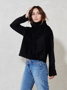 Why not go about your day feeling like you're wearing a soft, fuzzy cloud? We couldn't think of any reasons why you shouldn't, so we made the Wyoming Sweatshirt. It's a turtleneck fleece sweater with long sleeves and a wider fit. Look chic, stay cozy. Made from surplus poly fleece blend.