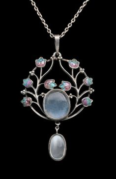 JESSIE M. KING 1875-1949 (Scottish) Liberty & Co Pendant  Silver Enamel Moonstone H: 5.1 cm (2.01 in)  W: 2.9 cm (1.14 in)  British, c.1900 Fitted Case