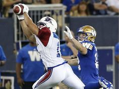WK 1 - June 24 216 - - - Montreal Alouettes' Chip Cox intercepts a pass intended for Winnipeg Blue Bombers' Ryan Smith during the first half of CFL action in Winnipeg Friday, June Winnipeg Blue Bombers, Montreal Alouettes, A Team, Football Helmets, June 24, Seasons, Friday, Action, Group Action