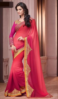 Flaunt a laid back style draped in this salmon and crimson color georgette sari. This saree is showing some really mesmerizing and creative patterns embroidered with lace, resham and sequins work. #fashionablesaree #trendyworksarees #doubleshadesaris
