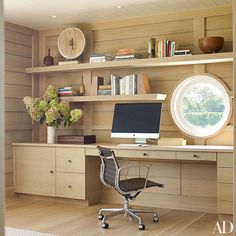 A porthole window lets light into the home office.