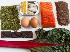 A nutrient-dense diet may help tamp down stress. And these foods may help boost our moods (clockwise from left): pumpkin seeds, anchovies, e...