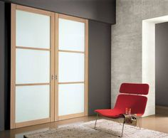 """BOSCA DOORS @ GLOTTMAN: Entry02 gliding door series: mullioned double sliding panel in Bleached Oak, with """"Bianco Latte"""" laminated glass. Soffitted recessed overhead aluminum track beam assembly.  Technical features: structure in wood-veneered pine-wood strip-board. Frame sizes: width 10 cm, thickness 4,4 cm. Mullion in solid wood. Maximum size for a single panel: height 280 cm, width 140 cm. Central panel, 6 mm, in laminated glass or compact form panel veneered in wood."""