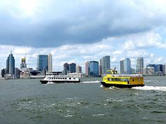 Ferries on the Hudson River, viewed from Battery Park City, New York City. August 4, 2014.