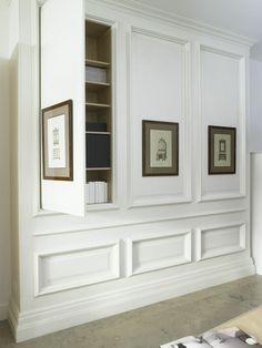 Paneling with hidden cupboard