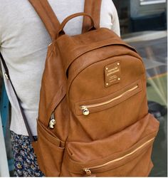 Totally coveting this: Monopoly Leather Backpack. Camel is my fave color-