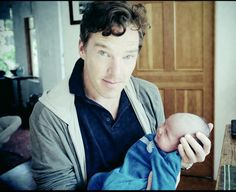 And another photo of our dear boy, holding a friend's child.  He has said one of his great regrets is that, unlike his younger friend, James McAvoy, he does not yet have children.  Women across the Internet, of course, have certainly offered their assistance…..