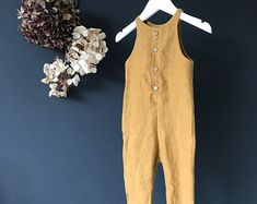 The Workwear Romper. 100% linen with cocnut button fastening front.