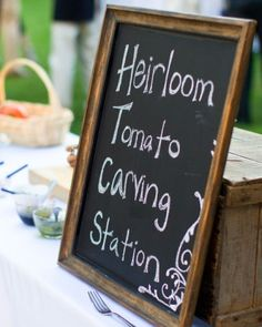 Love this idea--an heirloom tomato carving station, complete with olive oil and pesto options