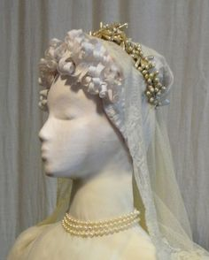 Figures had custom-made paper  wigs and matched accessories to enhance the ensembles. The Bride has a hairstyle inspired by portraits of Empress Josephine. Her long, narrow scarf/veil is 19th century lace, and the pear-shaped pear coronet is a vintage piece (probably 1930-40)