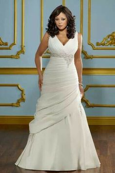 Plus size wedding gown.  That ruching and v neck are perfect at enhancing the figure.