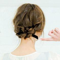 Alexa Chung with ribboned up-do