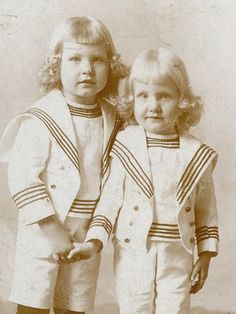 Little Brothers With Blond Curls In Sailor Suits